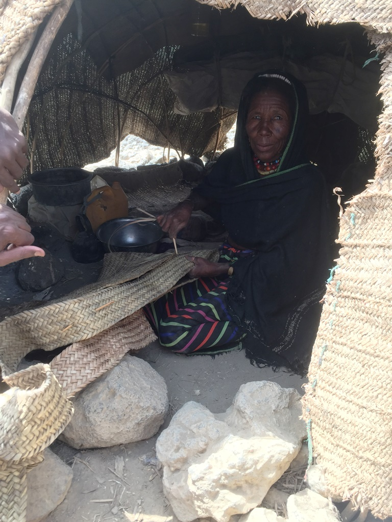 An Afar woman makes a traditional camel milk container
