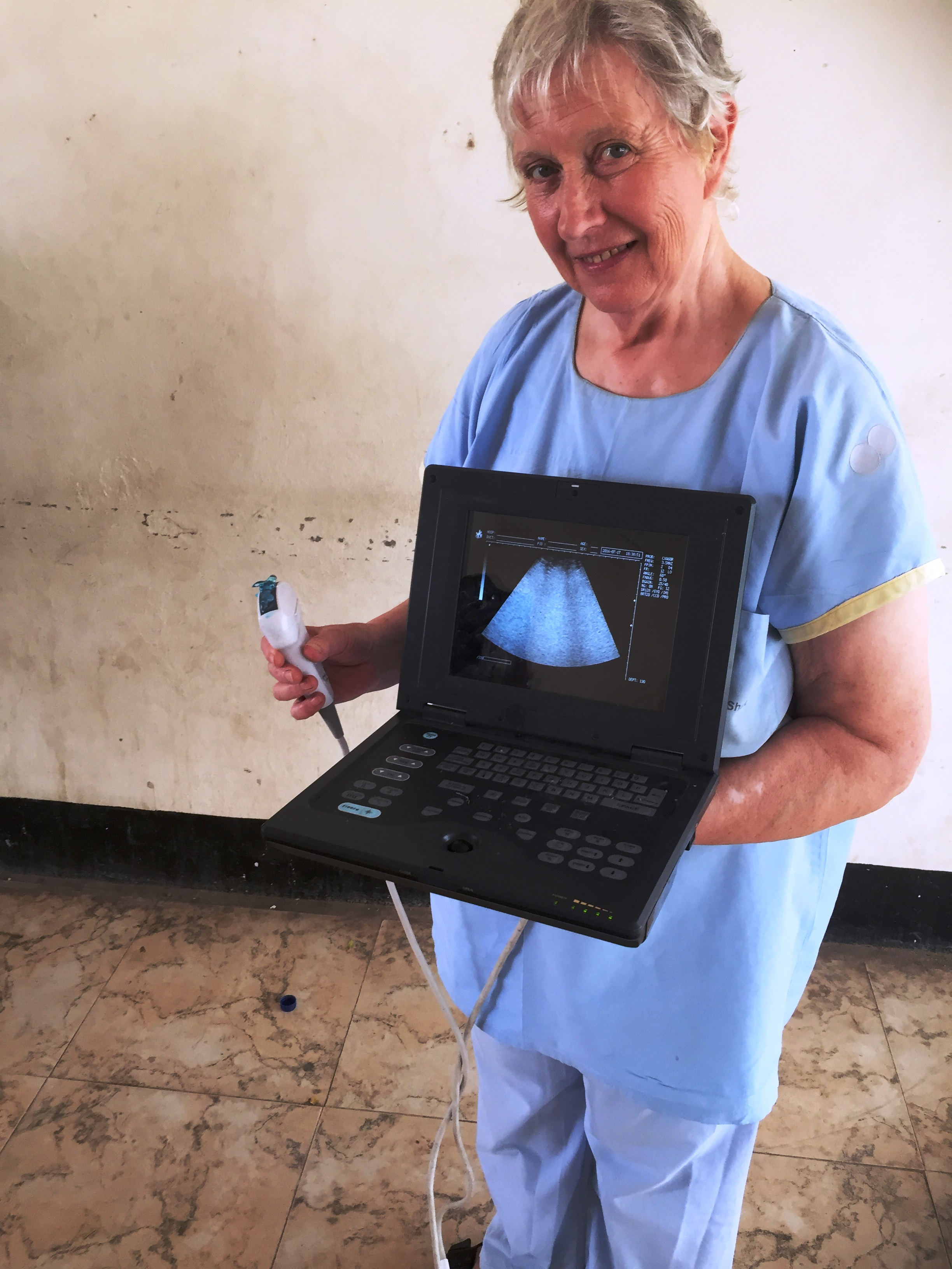 Dr. Margaret holds a portable ultrasound machine that was purchased with funds raised by the Can-Go Afar Foundation